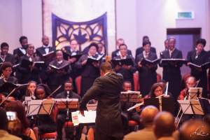 Hekima conducting the Dar Choral Society and Orchestra